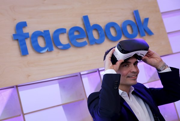 Facebook's Managing Director Northern, Central and Eastern Europe Ott poses for the photographer with a virtual reality headset at the new Facebook Innovation Hub during a preview media tour in Berlin